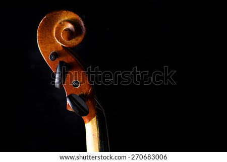 Close up of a violin isolated on a black background - stock photo