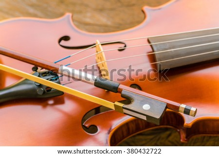 Close up of a violin on wooden surface