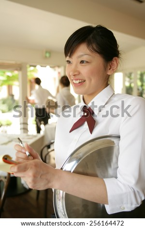 Close up of a waitress taking an order - stock photo