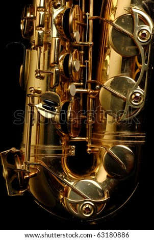 Close-up of a well used tenor saxophone on a black background