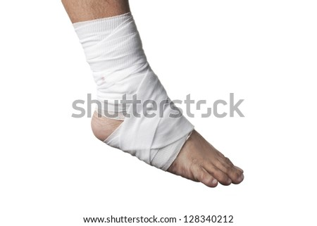Close-up of a white bandage in an injured ankle. - stock photo