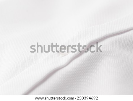 Close-up of a white dress shirt - stock photo