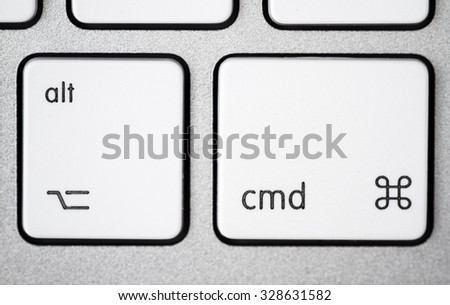 Close up of a white, gray computer keyboard. Focus on alt and cmd. - stock photo