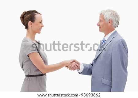 Close-up of a white hair man face to face and shaking hands with a woman against white background
