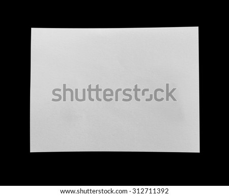 close up of a white note paper on black. Copy space - stock photo