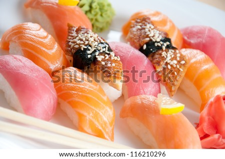 Close-up of a white plate with sushi set, horizontal shot - stock photo