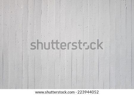 Close-up of a white wall with vertical striped pattern of exposed concrete  - stock photo