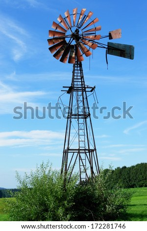 Close-up of a windmil and blue sky - stock photo