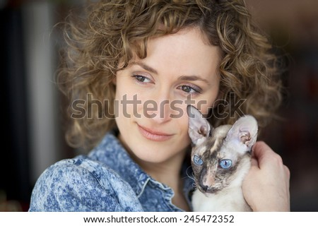 Close-up of a woman and cat - stock photo
