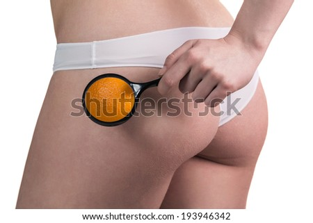 Close-up Of A Woman Checking Cellulite With Magnifying Glass - stock photo