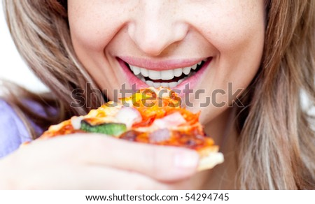 Close-up of a woman eating a pizza isolated on a white background
