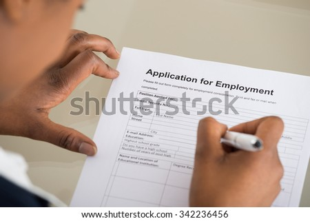 Close-up Of A Woman Filling Employment Form - stock photo