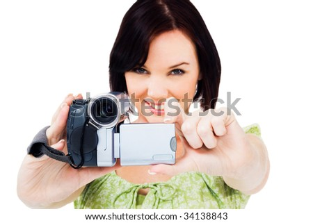 Close-up of a woman holding a home video camera isolated over white