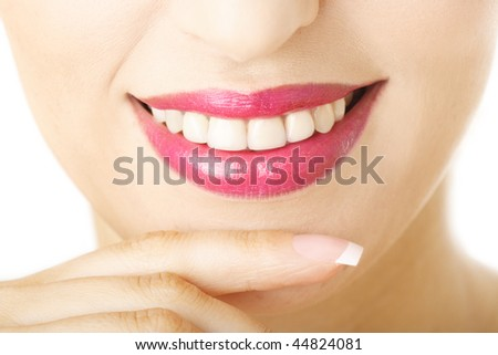 Close-up of a woman lips and teeth - stock photo