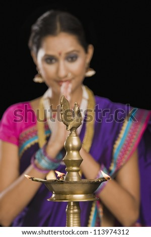 Close-up of a woman praying - stock photo