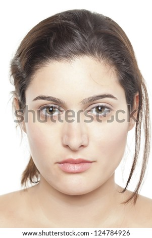 Close-up of a woman's face looking at the camera against the white background - stock photo