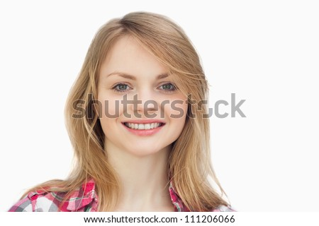 Close up of a woman smiling against a white background