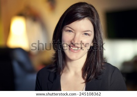 Close up of a woman smiling at the camera