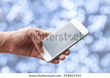 Close up of a woman using mobile smart phone with bokeh background - stock photo