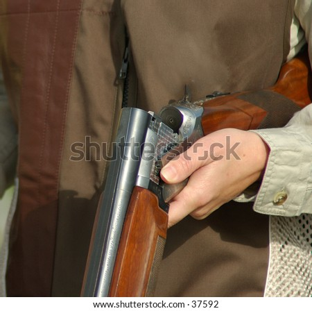 close up of a woman with an open a shotgun - stock photo