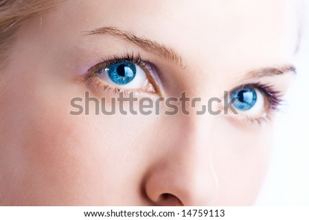 close up of a woman with blue eyes - stock photo