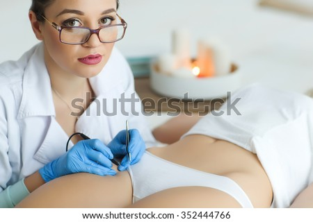Close-up of a woman with laser treatment at the clinic of beauty - stock photo