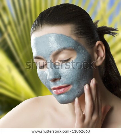 Close up of a woman  with spa mask on her face