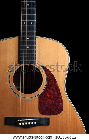 close up of a wooden guitar isolated on black - stock photo