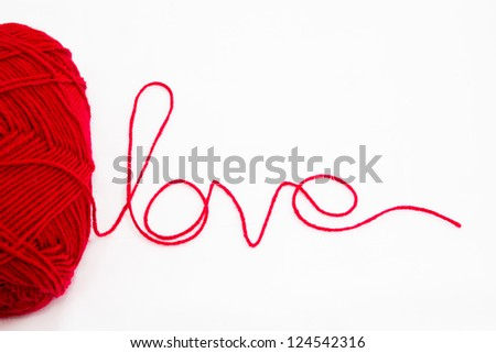 close up of a wool ball and love Letter on white background - stock photo