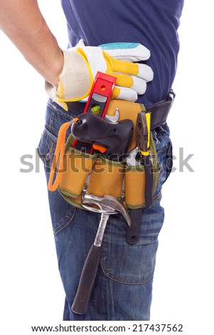 Close up of a worker with toolbelt and helmet, isolated on white background - stock photo