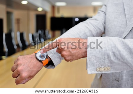 Close-up of a wristwatch as a concept of time in business - stock photo
