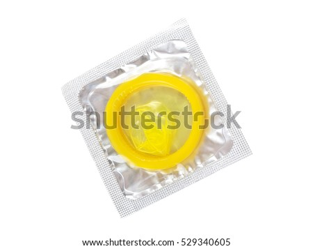Close up of a yellow condom on white background