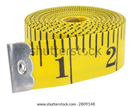 Close-up of a yellow measuring tape isolated on white. - stock photo