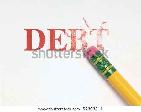 Close up of a yellow pencil erasing the word, 'debt' in red. - stock photo