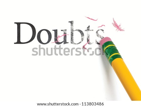 Close up of a yellow pencil erasing the word, 'Doubts.' Isolated on white.
