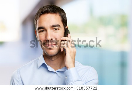 Close up of a young businessman calling on mobile phone