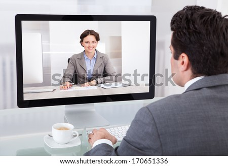 Close-up Of A Young Businessman Chatting With Her Colleague - stock photo