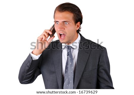 Close-up of a young businessman shouting on the phone