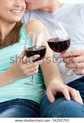 Close-up of a young couple drinking red wine at home