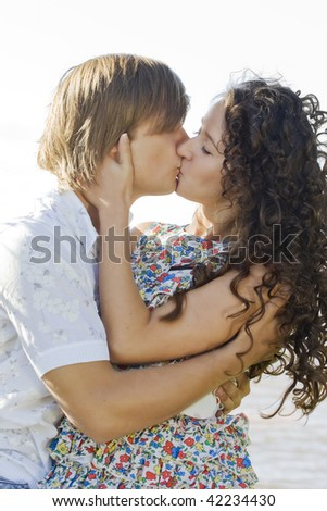 Close-up of a young couple kissing each other - stock photo