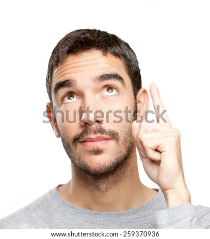 Close up of a young man pointing up - stock photo
