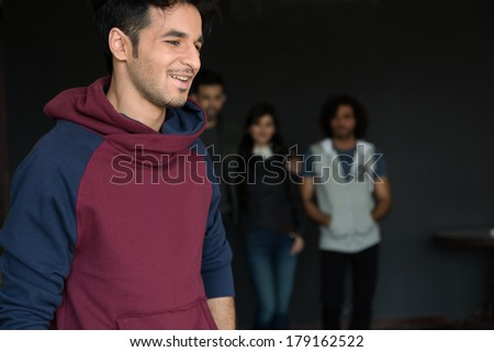 close up of a young man with group of friends in the background