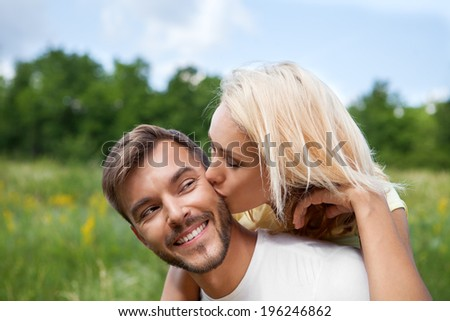 Close-up of a young woman embracing her boyfriend - stock photo