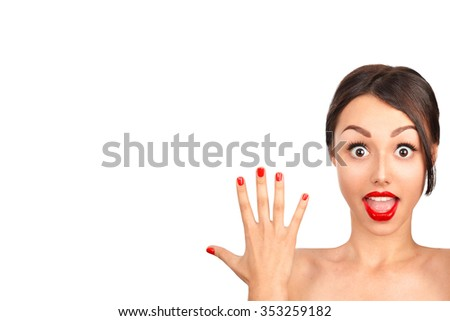 Close-up of a young woman looking surprised on white background - stock photo