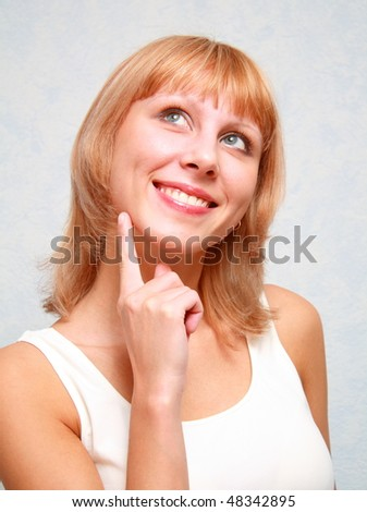Close-up of a young woman thinking. - stock photo