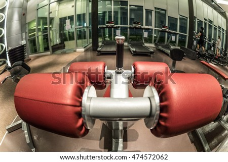 Close up of abdominals equipment  shot with fish-eye lens against gym atmostphere