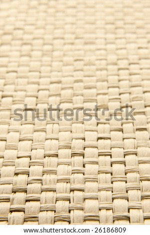 Close up of abstract yellow woven thatch textured background, shallow depth of field - stock photo