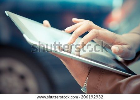 close up of african woman hands using tablet - stock photo
