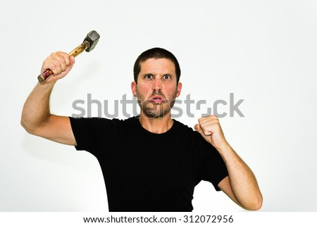 Close-up of aggressive young caucasian man trying to attack you with an hammer - isolated on white background