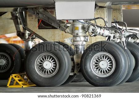 Close up of aircraft wheel at the hangar - stock photo